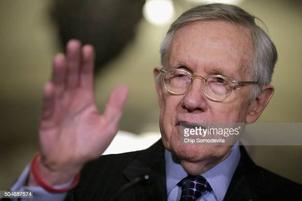 Senate Minority Leader Harry Reid talks to reporters following the Senate Democratic caucus policy luncheon at the US Capitol January 12 2016 in...