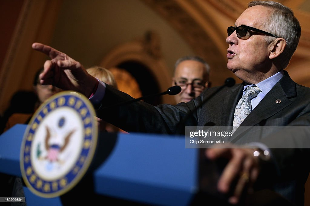 Senate Minority Leader Harry Reid (D-NV) talks with reporters after the weekly Democratic policy luncheon at the U.S. Capitol August 4, 2015 in Washington, DC. Reid said there would be enough support to move a cybersecurity bill forward if Democrats were able to offer relevant amendments.