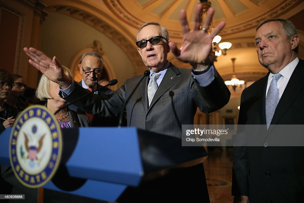 Senate Minority Leader <a gi-track='captionPersonalityLinkClicked' href=/galleries/search?phrase=Harry+Reid&family=editorial&specificpeople=203136 ng-click='$event.stopPropagation()'>Harry Reid</a> (D-NV) (C) talks with reporters with Sen. <a gi-track='captionPersonalityLinkClicked' href=/galleries/search?phrase=Charles+Schumer&family=editorial&specificpeople=171249 ng-click='$event.stopPropagation()'>Charles Schumer</a> (D-NY) (L) and Sen. Richard Durbin (D-IL) (R) after the weekly Democratic policy luncheon at the U.S. Capitol August 4, 2015 in Washington, DC. Reid said there would be enough support to move a cybersecurity bill forward if Democrats were able to offer relevant amendments.