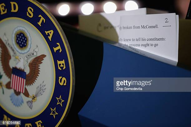 Senate Minority Leader Harry Reid's notes sit on the podium as he talks to reporters following their weekly policy luncheon at the US Capitol April 5...