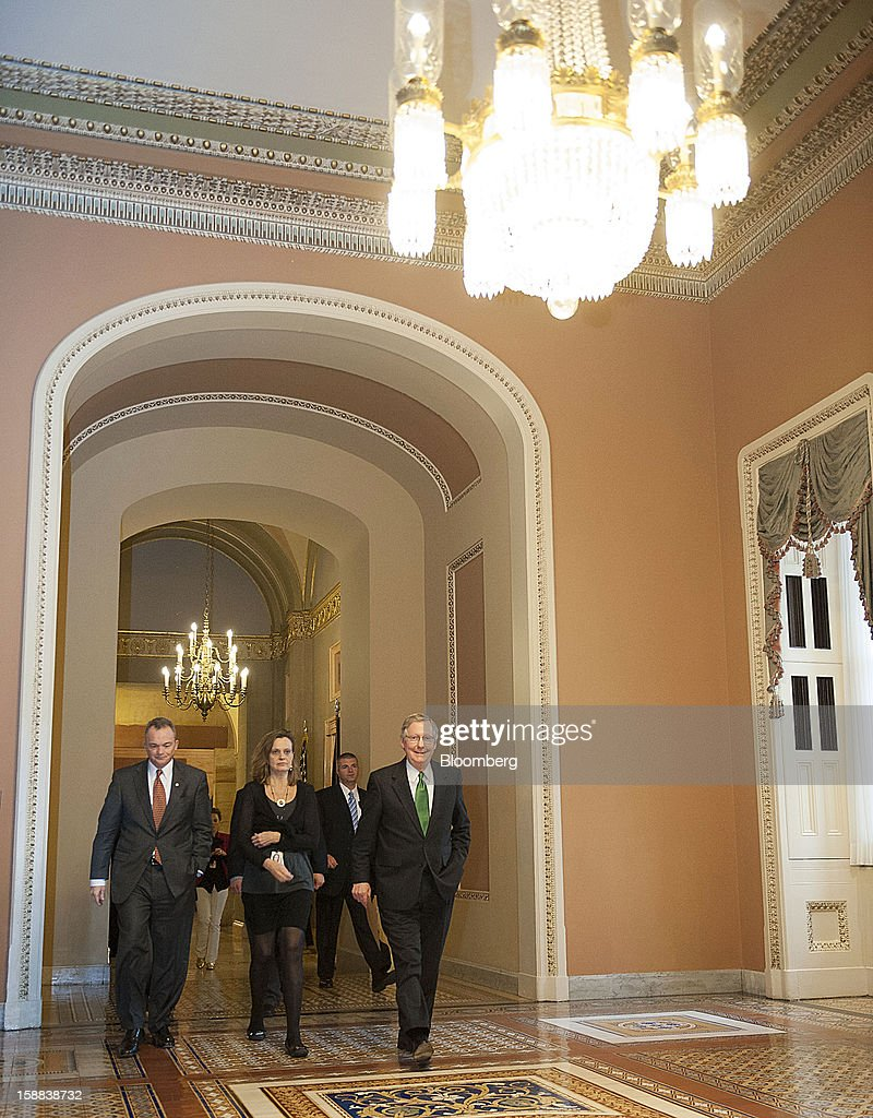 Senate Minority Leader Mitch McConnell, a Republican from Kentucky, right, walks to the floor of the Senate at the U.S. Capitol in Washington, D.C., U.S. on Monday, Dec. 31, 2012. U.S. lawmakers hurtled toward a midnight deadline to avert hundreds of billions of dollars in tax increases and spending cuts, struggling to extract the country from a fiscal trap they created. Photographer: Jay Mallin/Bloomberg via Getty Images Mitch McConnell