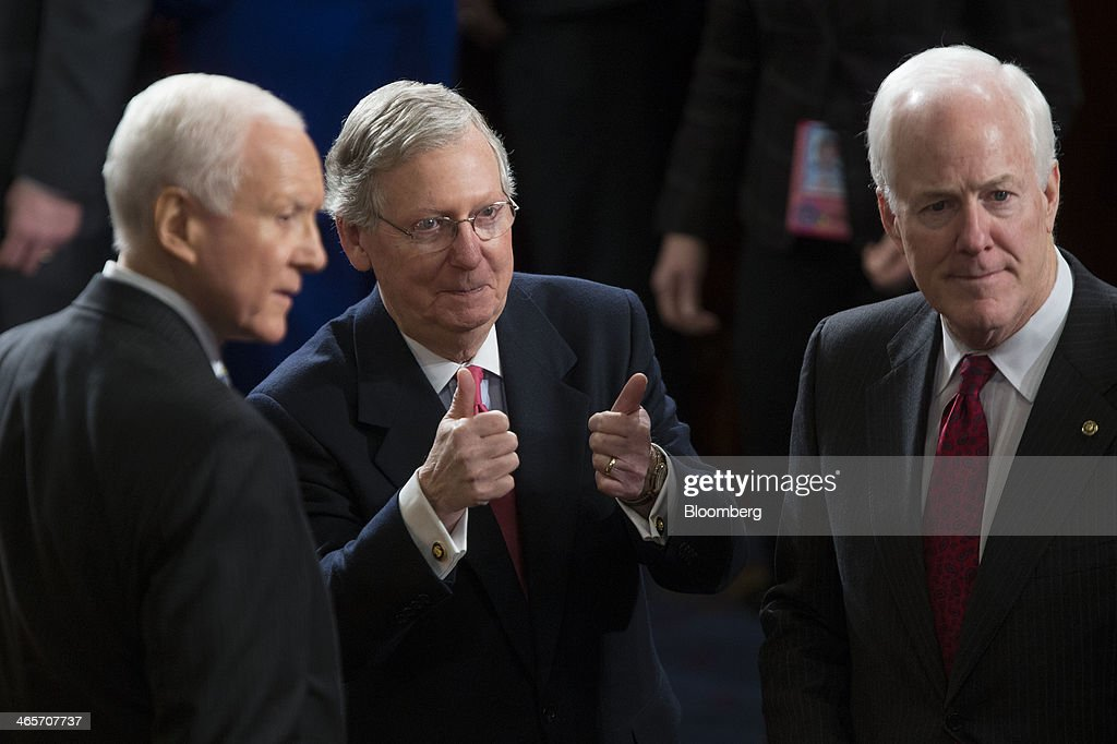Senate Minority Leader <a gi-track='captionPersonalityLinkClicked' href=/galleries/search?phrase=Mitch+McConnell&family=editorial&specificpeople=217985 ng-click='$event.stopPropagation()'>Mitch McConnell</a>, a Republican from Kentucky, center, gestures before U.S. President Barack Obama, not pictured, delivers the State of the Union address to a joint session of Congress at the Capitol in Washington, D.C., U.S., on Tuesday, Jan. 28, 2014. Obama offered modest steps to chip away at the country's economic and social challenges in a State of the Union address that reflects the limits of his power to sway Congress. Photographer: Andrew Harrer/Bloomberg via Getty Images