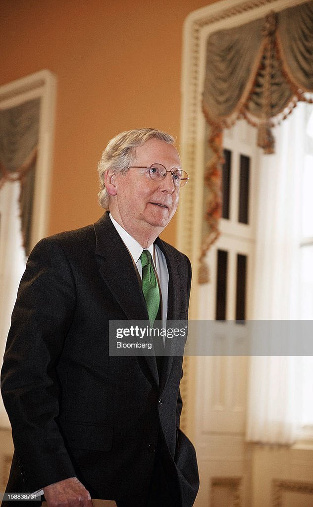 Senate Minority Leader Mitch McConnell, a Republican from Kentucky, walks to the floor of the Senate at the U.S. Capitol in Washington, D.C., U.S., on Monday, Dec. 31, 2012. U.S. lawmakers hurtled toward a midnight deadline to avert hundreds of billions of dollars in tax increases and spending cuts, struggling to extract the country from a fiscal trap they created. Photographer: Jay Mallin/Bloomberg via Getty Images