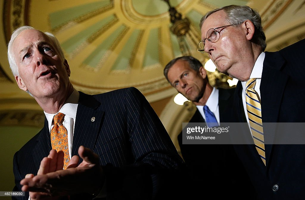 Senate Minority Leader Mitch McConnell and Sen John Cornyn answer questions during a press conference following the weekly Republican policy luncheon...
