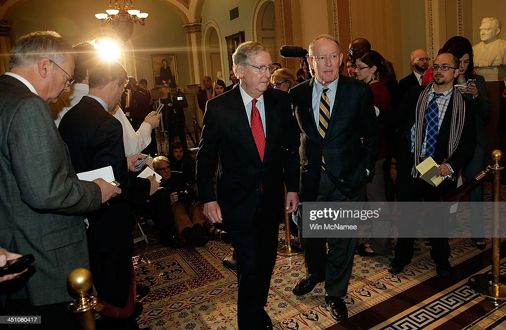 Senate Minority Leader Mitch McConnell (R-KY) (L) and Sen. Lamar Alexander (R-TN) depart a press conference after the U.S. Senate passed the 'nuclear option', a controversial rules change relating to filibusters, at the U.S. Capitol November 21, 2013 in Washington, DC. The Senate voted 52-48 to change Senate rules on the filibusters for most presidential nominations with a simple majority vote.