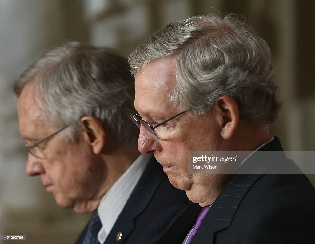 Senate Minority Leader <a gi-track='captionPersonalityLinkClicked' href=/galleries/search?phrase=Mitch+McConnell&family=editorial&specificpeople=217985 ng-click='$event.stopPropagation()'>Mitch McConnell</a> (R-KY) (R) and Senate Majority Leader <a gi-track='captionPersonalityLinkClicked' href=/galleries/search?phrase=Harry+Reid+-+Politician&family=editorial&specificpeople=203136 ng-click='$event.stopPropagation()'>Harry Reid</a> (D-NV) attend a Congressional Gold Medal ceremony at the U.S. Capitol, June 26, 2014 in Washington, DC. Israeli President Shimon Peres was pressented with the Congressional Gold Medal which recognizes those who have performed an achievement that has an impact on American history and culture.