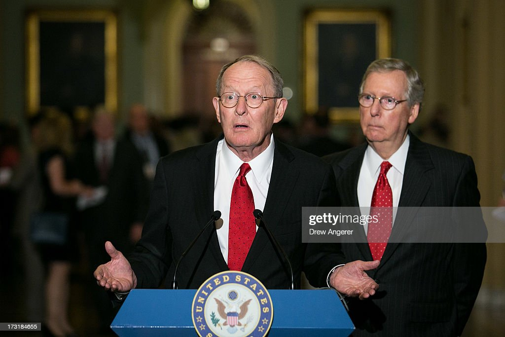 Senate Minority Leader <a gi-track='captionPersonalityLinkClicked' href=/galleries/search?phrase=Mitch+McConnell&family=editorial&specificpeople=217985 ng-click='$event.stopPropagation()'>Mitch McConnell</a> (R-KY) (R) and U.S. Sen. <a gi-track='captionPersonalityLinkClicked' href=/galleries/search?phrase=Lamar+Alexander&family=editorial&specificpeople=211236 ng-click='$event.stopPropagation()'>Lamar Alexander</a> (R-TN) give a press conference after meeting with fellow Republican Senators on Capitol Hill, July 9, 2013 in Washington, DC. The senators fielded questions about student loan legislation.