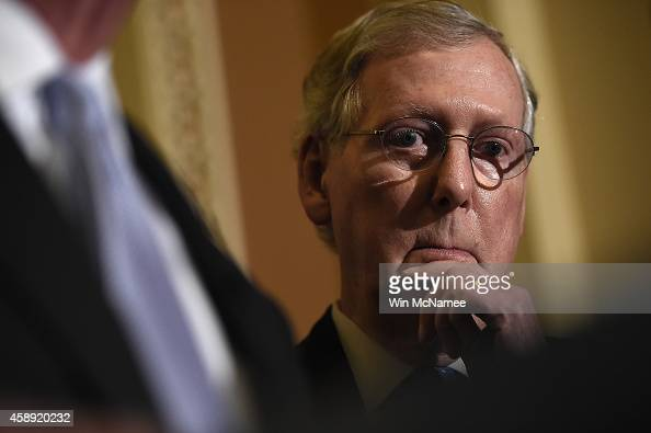 Senate Minority Leader Mitch McConnell answers questions following the weekly Republican policy luncheon at the US Capitol November 13 2014 in...