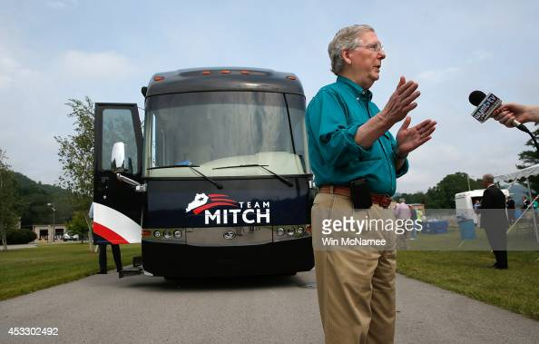 Senate Minority Leader Mitch McConnell answers questions from a reporter while campaigning at Cumberland Valley Electric during a two day bus tour of...