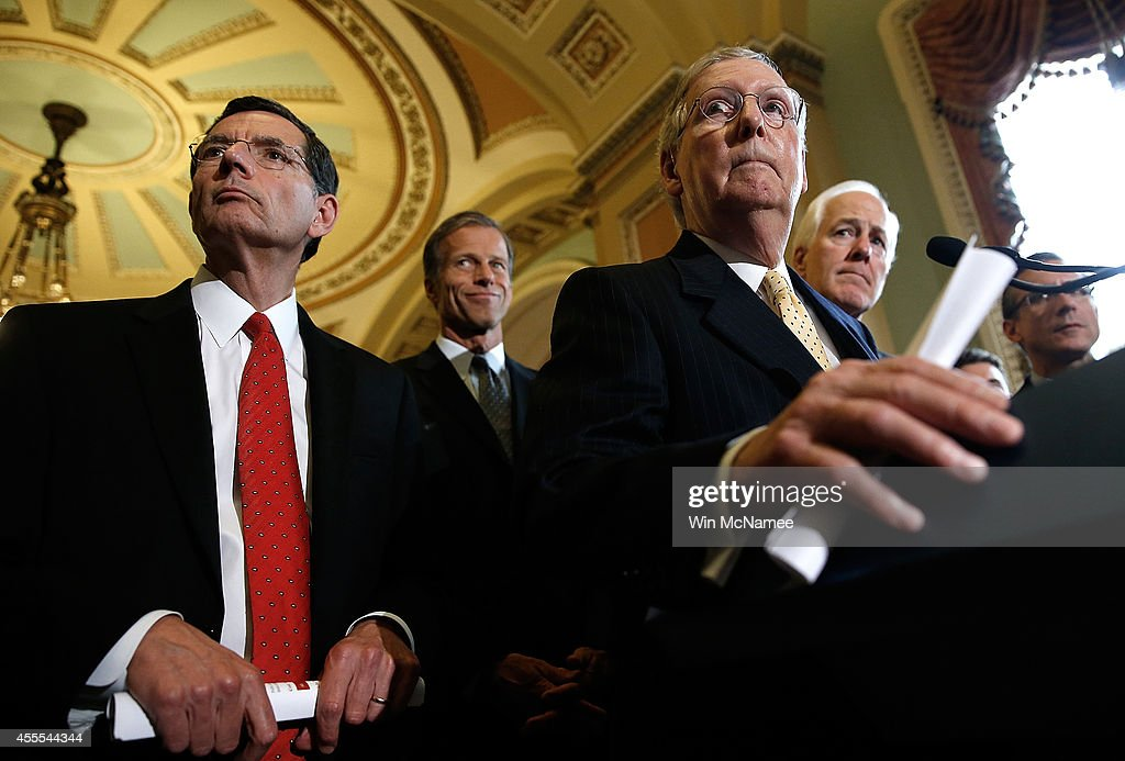 Senate Minority Leader <a gi-track='captionPersonalityLinkClicked' href=/galleries/search?phrase=Mitch+McConnell&family=editorial&specificpeople=217985 ng-click='$event.stopPropagation()'>Mitch McConnell</a> (2nd R) (R-KY) answers questions with Republican leaders following the weekly Republican policy luncheon at the U.S. Capitol September 16, 2014 in Washington, DC. McConnell answered questions about the midterm elections and the remaining legislative agenda for the Senate. Also pictured (L-R) are Sen. <a gi-track='captionPersonalityLinkClicked' href=/galleries/search?phrase=John+Barrasso&family=editorial&specificpeople=5312607 ng-click='$event.stopPropagation()'>John Barrasso</a> (R-WY), Sen. <a gi-track='captionPersonalityLinkClicked' href=/galleries/search?phrase=John+Thune&family=editorial&specificpeople=534356 ng-click='$event.stopPropagation()'>John Thune</a> (R-SD) and Sen. <a gi-track='captionPersonalityLinkClicked' href=/galleries/search?phrase=John+Cornyn&family=editorial&specificpeople=154884 ng-click='$event.stopPropagation()'>John Cornyn</a> (R-TX).