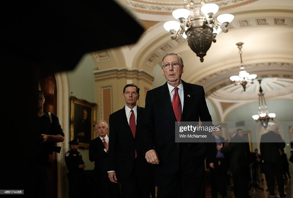 Senate Minority Leader <a gi-track='captionPersonalityLinkClicked' href=/galleries/search?phrase=Mitch+McConnell&family=editorial&specificpeople=217985 ng-click='$event.stopPropagation()'>Mitch McConnell</a> (R) (R-KY) arrives at a press conference following the weekly policy luncheon of the Republican caucus at the U.S. Capitol March 3, 2015 in Washington, DC. McConnell answered questions on the DHS funding bill and Israeli Prime Minister Benjamin Netanyahu's speech to a joint meeting of Congress. Also pictured is Sen. <a gi-track='captionPersonalityLinkClicked' href=/galleries/search?phrase=John+Barrasso&family=editorial&specificpeople=5312607 ng-click='$event.stopPropagation()'>John Barrasso</a> (L) ) (R-WY).