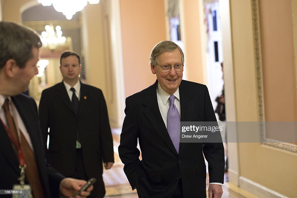 Senate Minority Leader <a gi-track='captionPersonalityLinkClicked' href=/galleries/search?phrase=Mitch+McConnell&family=editorial&specificpeople=217985 ng-click='$event.stopPropagation()'>Mitch McConnell</a> (R-KY) leaves his office and walks toward the Senate floor on Capitol Hill December 28, 2012 in Washington, DC. The Senate was back in session on Friday to deal with the looming 'fiscal cliff' issue.