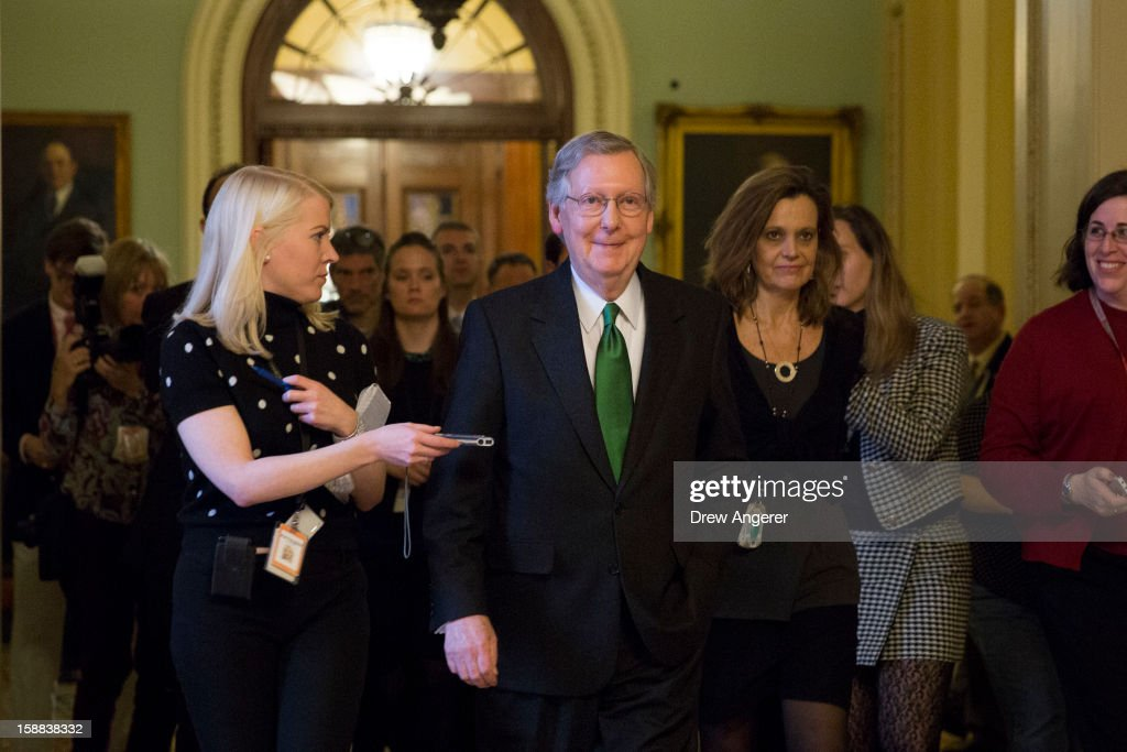 Senate Minority Leader <a gi-track='captionPersonalityLinkClicked' href=/galleries/search?phrase=Mitch+McConnell&family=editorial&specificpeople=217985 ng-click='$event.stopPropagation()'>Mitch McConnell</a> (R-KY) leaves the Senate floor and walks back to his office, on Capitol Hill December 31, 2012 in Washington, DC. The House and Senate are both still in session on New Year's Eve to try to deal with the looming 'fiscal cliff.'