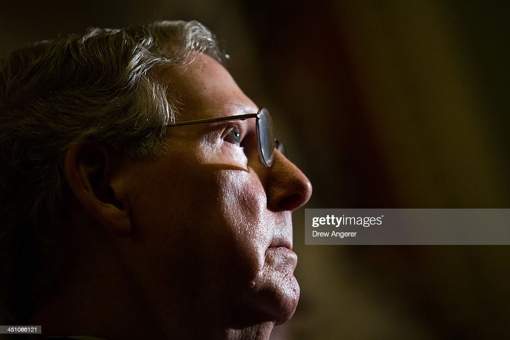 Senate Minority Leader <a gi-track='captionPersonalityLinkClicked' href=/galleries/search?phrase=Mitch+McConnell&family=editorial&specificpeople=217985 ng-click='$event.stopPropagation()'>Mitch McConnell</a> (R-KY) looks on during a news conference on Capitol Hill, November 21, 2013 in Washington, DC. The Senate voted 52-48 to invoke the so-called 'nuclear option', voting to change Senate rules on the controversial filibuster for most presidential nominations with a simple majority vote.