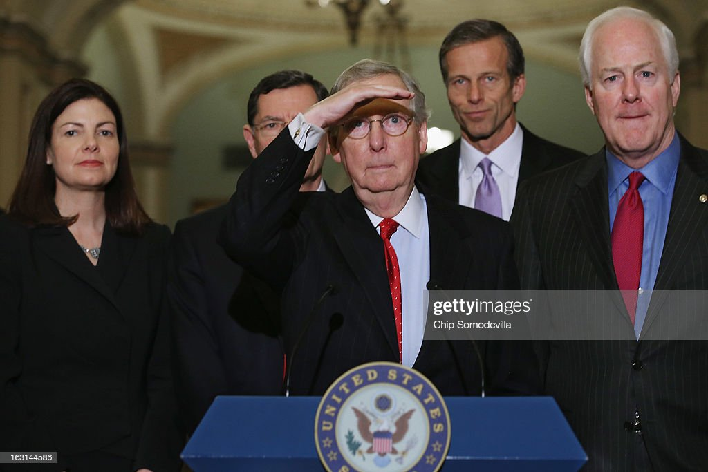 Senate Minority Leader Mitch McConnell (R-KY) (C) looks out at the television cameras before talking to the news media with (L-R) Sen. Kelly Ayotte (R-NH), Sen. John Barrasso (R-WY), Sen. John Thune (R-SD) and Sen. John Cornyn (R-TX) after the weekly Senate Republican policy luncheon at the U.S. Capitol March 5, 2013 in Washington, DC. McConnell said that Republicans and Democrats are closer to finding common ground on a continuing resolution that would fund the federal government for the remainder of the fiscal year.