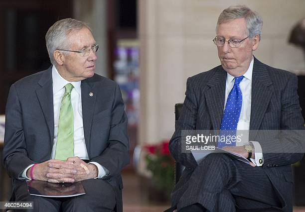 US Senate Minority Leader Mitch McConnell Republican of Kentucky and Senate Majority Leader Harry Reid Democrat from Nevada attend a ceremony to...