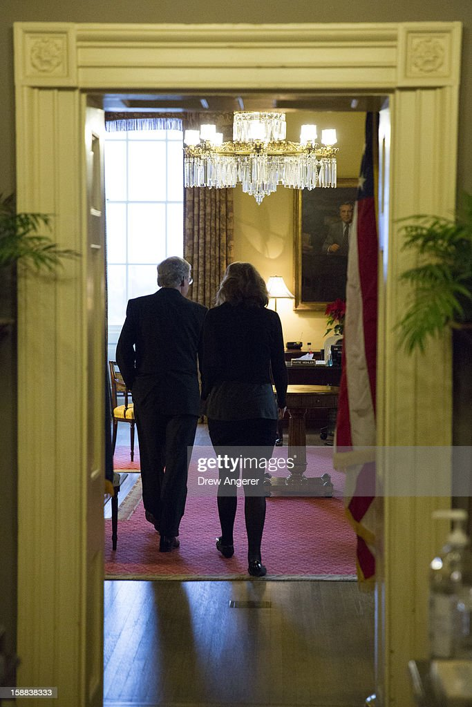 Senate Minority Leader Mitch McConnell (R-KY) (L) returns to his office with an aide after speaking on the Senate floor, on Capitol Hill December 31, 2012 in Washington, DC. The House and Senate are both still in session on New Year's Eve to try to deal with the looming 'fiscal cliff.'