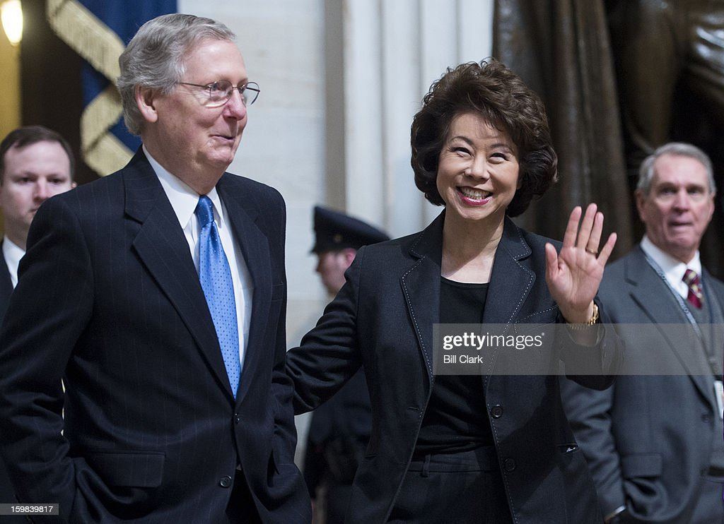 Senate Minority Leader Mitch McConnell, R-Ky., and his wife former Labor Secretary Elaine Chao walk through the Capitol Rotunda as they arrive for the luncheon in Statuary Hall for President Barack Obama's inauguration ceremony on Monday, Jan. 21, 2013.