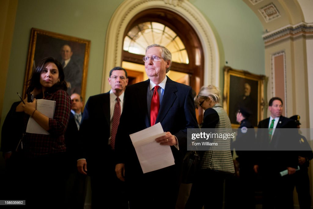 Senate Minority Leader Mitch McConnell, R-Ky., center, and Sen. John Barrasso, R-Wyo., Republican Policy Committee chairman, arrive for news conference in the Ohio Clock Corridor after the senate luncheons in the Capitol.