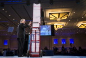 Senate Minority Leader Mitch McConnell RKy speaks next to a tower of 20000 pages of health care rules and regulations at the 2013 Conservative...