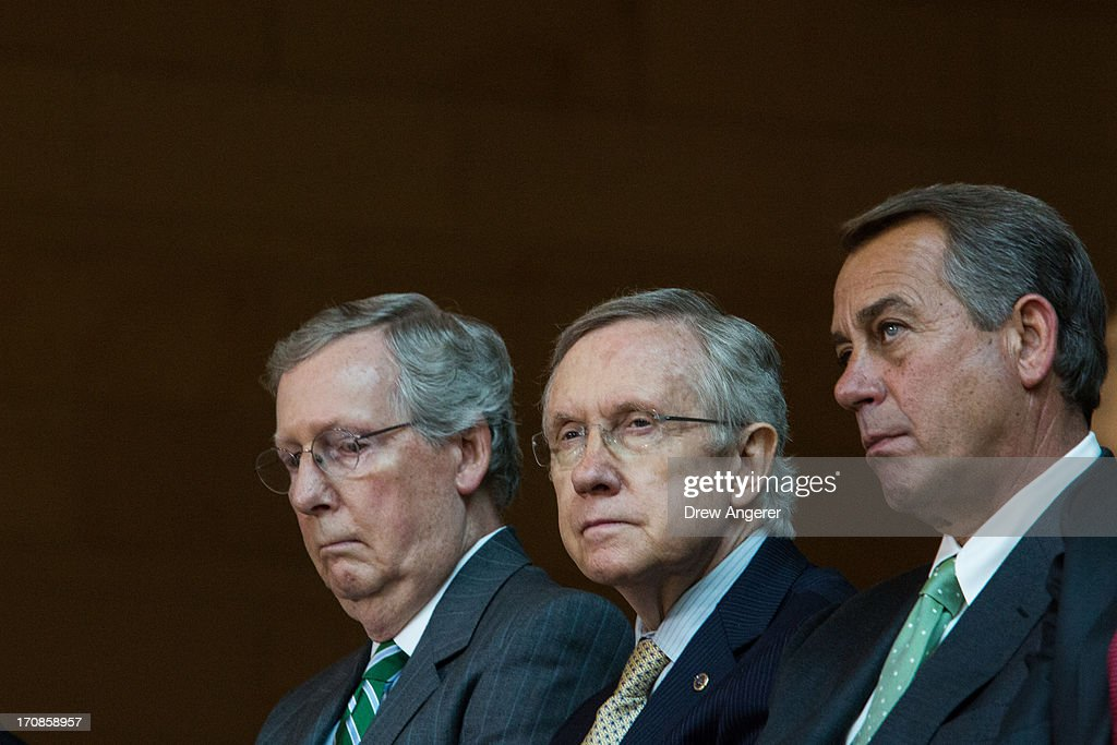 Senate Minority Leader <a gi-track='captionPersonalityLinkClicked' href=/galleries/search?phrase=Mitch+McConnell&family=editorial&specificpeople=217985 ng-click='$event.stopPropagation()'>Mitch McConnell</a> (R-KY), Senate Majority Leader <a gi-track='captionPersonalityLinkClicked' href=/galleries/search?phrase=Harry+Reid+-+Politician&family=editorial&specificpeople=203136 ng-click='$event.stopPropagation()'>Harry Reid</a> (D-NV), and Speaker of the House <a gi-track='captionPersonalityLinkClicked' href=/galleries/search?phrase=John+Boehner&family=editorial&specificpeople=274752 ng-click='$event.stopPropagation()'>John Boehner</a> (R-OH) are seen during a dedication ceremony for the new Frederick Douglass Statue in Emancipation Hall in the Capitol Visitor Center, at the U.S. Capitol, on June 19, 2013 in Washington, DC. The 7 foot bronze statue of Douglass joins fellow black Americans Rosa Parks, Martin Luther King Jr. and Sojourner Truth on permanent display in the Capitol's Emancipation Hall.