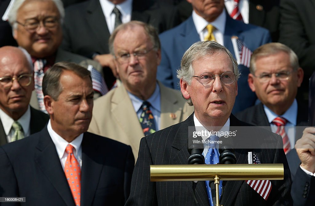 Senate Minority Leader <a gi-track='captionPersonalityLinkClicked' href=/galleries/search?phrase=Mitch+McConnell&family=editorial&specificpeople=217985 ng-click='$event.stopPropagation()'>Mitch McConnell</a> (R-KY) speaks during a September 11th remembrance ceremony on the steps of the U.S. Capitol September 11, 2013 in Washington, DC. The nation is commemorating the anniversary of the 2001 attacks which resulted in the deaths of nearly 3,000 people after two hijacked planes crashed into the World Trade Center, one into the Pentagon in Arlington, Virginia and one crash landed in Shanksville, Pennsylvania.