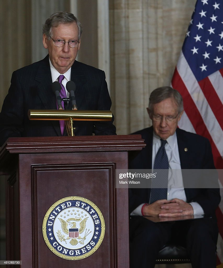 Senate Minority Leader <a gi-track='captionPersonalityLinkClicked' href=/galleries/search?phrase=Mitch+McConnell&family=editorial&specificpeople=217985 ng-click='$event.stopPropagation()'>Mitch McConnell</a> (R-KY) (L) speaks while Senate Majority Leader <a gi-track='captionPersonalityLinkClicked' href=/galleries/search?phrase=Harry+Reid+-+Politician&family=editorial&specificpeople=203136 ng-click='$event.stopPropagation()'>Harry Reid</a> (D-NV) listens during a Congressional Gold Medal ceremony at the U.S. Capitol, June 26, 2014 in Washington, DC. Israeli President Shimon Peres was pressented with the Congressional Gold Medal which recognizes those who have performed an achievement that has an impact on American history and culture.