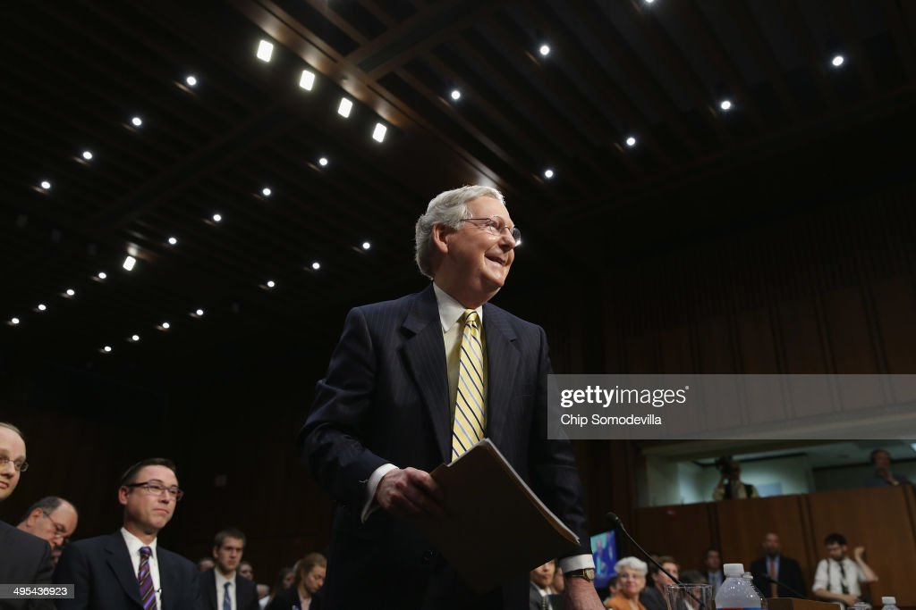Senate Minority Leader Mitch McConnell (R-KY) stands up after testifying to the Senate Judiciary Committee about political donations and freedom of speech in the Hart Senate Office Building June 3, 2014 in Washington, DC. Liberal political groups delivered two million petitions calling for a campaign finance constitutional amendment and pushing for '...a proposed constitutional amendment to restore the ability of Congress and the states to regulate the raising and spending of money in elections.'