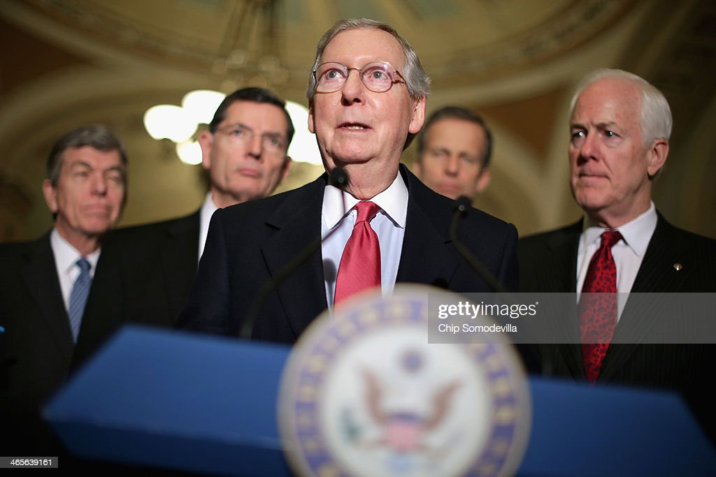 Senate Minority Leader <a gi-track='captionPersonalityLinkClicked' href=/galleries/search?phrase=Mitch+McConnell&family=editorial&specificpeople=217985 ng-click='$event.stopPropagation()'>Mitch McConnell</a> (R-KY) (C) talks to reporters after the weekly Republican Senate caucus luncheon with (L-R) Sen. <a gi-track='captionPersonalityLinkClicked' href=/galleries/search?phrase=Roy+Blunt&family=editorial&specificpeople=233679 ng-click='$event.stopPropagation()'>Roy Blunt</a> (R-MO), Sen. John Barrasso (R-WY), Sen. <a gi-track='captionPersonalityLinkClicked' href=/galleries/search?phrase=John+Thune&family=editorial&specificpeople=534356 ng-click='$event.stopPropagation()'>John Thune</a> (R-SD) and Sen. <a gi-track='captionPersonalityLinkClicked' href=/galleries/search?phrase=John+Cornyn&family=editorial&specificpeople=154884 ng-click='$event.stopPropagation()'>John Cornyn</a> (R-TX) at the U.S. Capitol January 28, 2014 in Washington, DC. Senate Republicans took swings at President Barack Obama and his policies hours before he is scheduled to deliver his sixth State of the Union speech before a joint session of Congress.