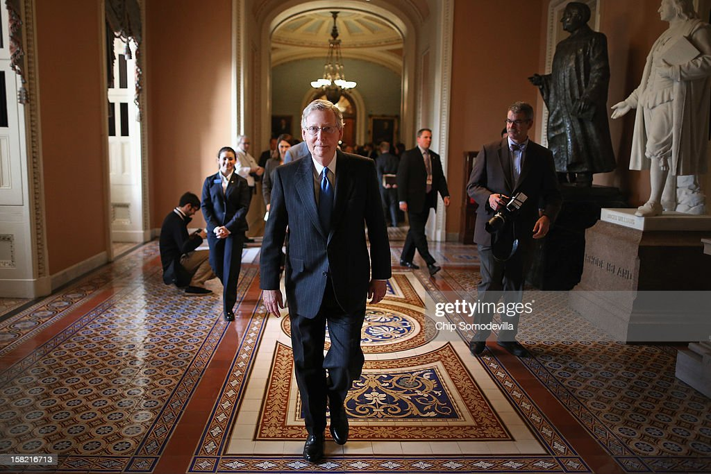 Senate Minority Leader <a gi-track='captionPersonalityLinkClicked' href=/galleries/search?phrase=Mitch+McConnell&family=editorial&specificpeople=217985 ng-click='$event.stopPropagation()'>Mitch McConnell</a> (R-KY) walks back to his office after talking to reporters at the U.S. Capitol December 11, 2012 in Washington, DC. McConnell and the Senate Republicans met for their weekly policy luncheon meeting and, with the 'fiscal cliff' looming, he said President Barack Obama and Senate Democrats have 'refused to be pinned down on any spending cuts.'
