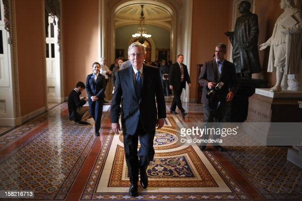 Senate Minority Leader Mitch McConnell walks back to his office after talking to reporters at the US Capitol December 11 2012 in Washington DC...