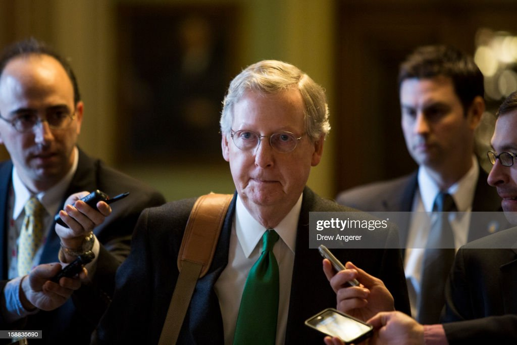 Senate Minority Leader <a gi-track='captionPersonalityLinkClicked' href=/galleries/search?phrase=Mitch+McConnell&family=editorial&specificpeople=217985 ng-click='$event.stopPropagation()'>Mitch McConnell</a> (R-KY) walks to his office on Capitol Hill December 31, 2012 in Washington, DC. The House and Senate are both still in session on New Year's Eve to try to deal with the looming 'fiscal cliff.'