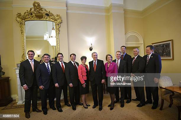 Senate Minority Leader Mitch McConnell welcomes new Republican senatorselect to his Senate office in the US Capitol November 12 2014 in Washington DC...