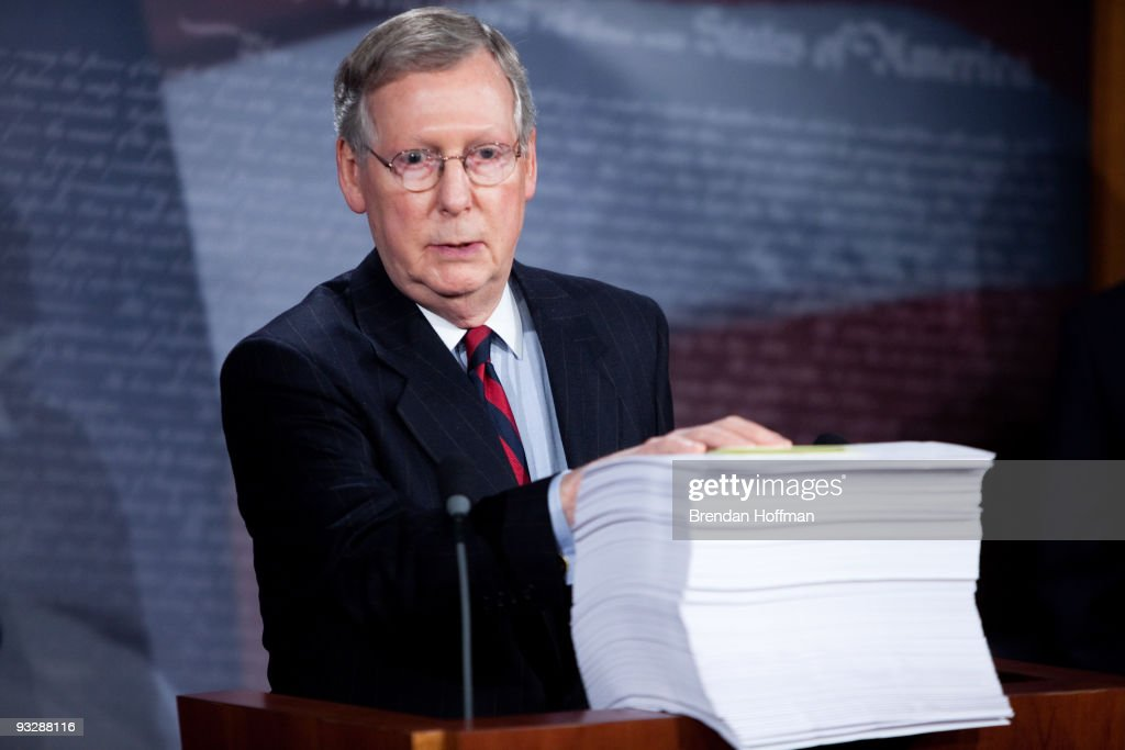 Senate Minority Leader Mitch McConnell with a copy of the Senate's health care reform legislation in front of him holds a news conference regarding...