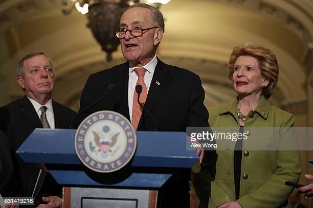 S Senate Minority Leader Sen Charles Schumer speaks as Senate Minority Whip Sen Richard Durbin and Sen Debbie Stabenow listen during a news briefing...