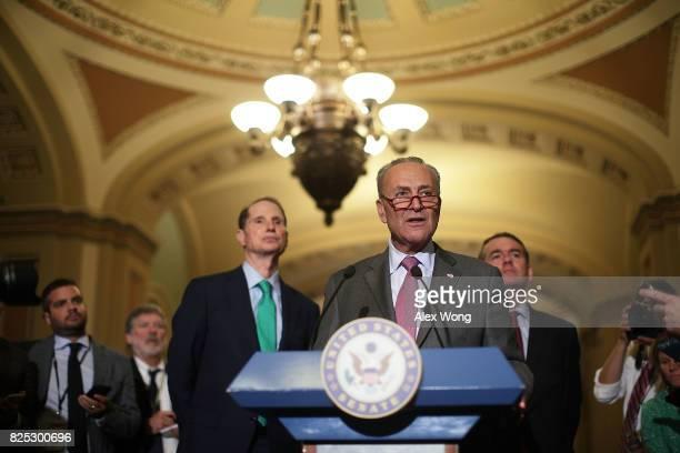 S Senate Minority Leader Sen Chuck Schumer speaks as Sen Ron Wyden and Sen Michael Bennet listen during a media briefing at the Capitol August 1 2017...