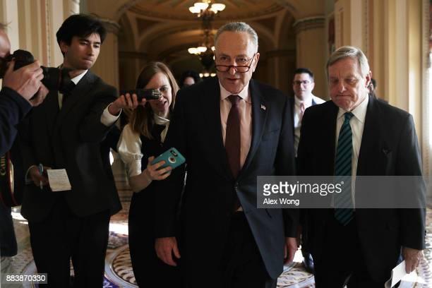S Senate Minority Leader Sen Chuck Schumer speaks to members of the media as he walks with Senate Minority Whip Sen Dick Durbin at the Capitol...