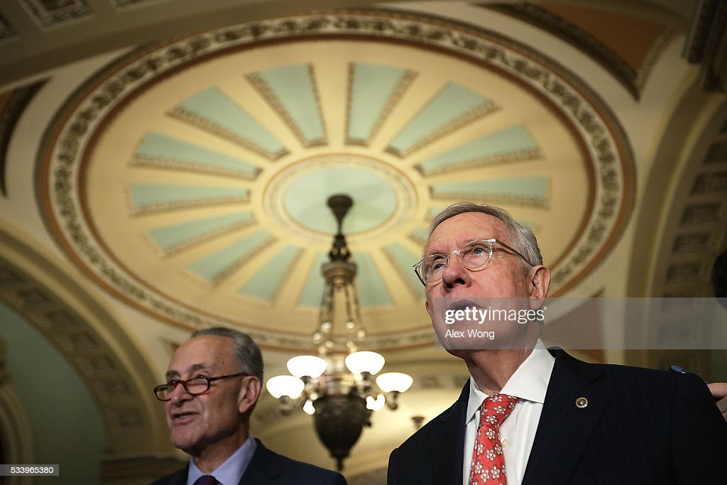 U.S. Senate Minority Leader Sen. <a gi-track='captionPersonalityLinkClicked' href=/galleries/search?phrase=Harry+Reid+-+Pol%C3%ADtico&family=editorial&specificpeople=203136 ng-click='$event.stopPropagation()'>Harry Reid</a> (D-NV) (R) and Sen. <a gi-track='captionPersonalityLinkClicked' href=/galleries/search?phrase=Charles+Schumer&family=editorial&specificpeople=171249 ng-click='$event.stopPropagation()'>Charles Schumer</a> (D-NY) (L) participate in a news briefing after the weekly Senate Democratic Policy Committee luncheon May 24, 2016 on Capitol Hill in Washington, DC. Senate Democrats held a policy luncheon to discuss Democratic agenda.