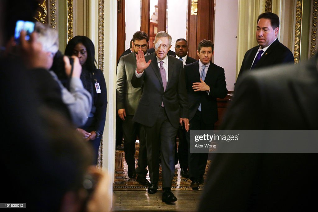 U.S. Senate Minority Leader Sen. <a gi-track='captionPersonalityLinkClicked' href=/galleries/search?phrase=Harry+Reid+-+Politiker&family=editorial&specificpeople=203136 ng-click='$event.stopPropagation()'>Harry Reid</a> (D-NV) (3rd L) arrives at the Senate Democratic weekly policy luncheon at the U.S. Capitol January 20, 2015 on Capitol Hill in Washington, DC. Sen. Reid has returned to work on January 20, after he was injured from a New Years Day exercise accident, which caused broken bones and temporary loss of vision in his right eye.