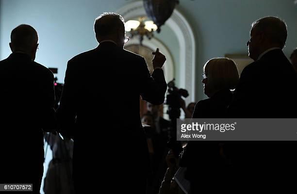 US Senate Minority Leader Sen Harry Reid Sen Charles Schumer Sen Patty Murray and Senate Minority Whip Sen Richard Durbin speak to members of the...