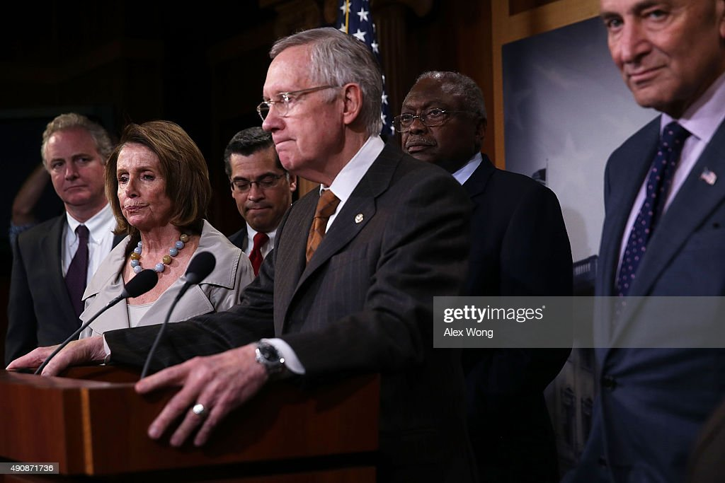 U.S. Senate Minority Leader Sen. <a gi-track='captionPersonalityLinkClicked' href=/galleries/search?phrase=Harry+Reid+-+Politician&family=editorial&specificpeople=203136 ng-click='$event.stopPropagation()'>Harry Reid</a> (D-NV) (4TH L) speaks as (L-R) Rep. <a gi-track='captionPersonalityLinkClicked' href=/galleries/search?phrase=Chris+Van+Hollen&family=editorial&specificpeople=3964585 ng-click='$event.stopPropagation()'>Chris Van Hollen</a> (D-MD), House Minority Leader Rep. <a gi-track='captionPersonalityLinkClicked' href=/galleries/search?phrase=Nancy+Pelosi&family=editorial&specificpeople=169883 ng-click='$event.stopPropagation()'>Nancy Pelosi</a> (D-CA), Rep. <a gi-track='captionPersonalityLinkClicked' href=/galleries/search?phrase=Xavier+Becerra&family=editorial&specificpeople=2369133 ng-click='$event.stopPropagation()'>Xavier Becerra</a> (D-CA), Assistant House Minority Leader Rep. <a gi-track='captionPersonalityLinkClicked' href=/galleries/search?phrase=James+Clyburn&family=editorial&specificpeople=668762 ng-click='$event.stopPropagation()'>James Clyburn</a> (D-SC), and Sen. <a gi-track='captionPersonalityLinkClicked' href=/galleries/search?phrase=Charles+Schumer&family=editorial&specificpeople=171249 ng-click='$event.stopPropagation()'>Charles Schumer</a> (D-NY) listen during a news conference October 1, 2015 at the U.S. Capitol in Washington, DC. Senate and House Democratic leaders held the news conference to call for 'constructive, bipartisan budget negotiations.'