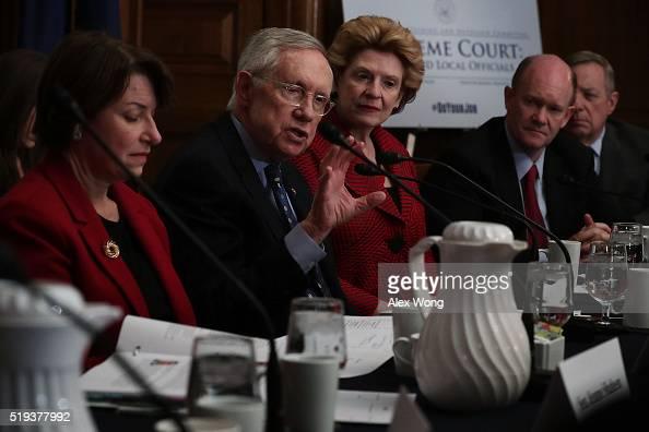 S Senate Minority Leader Sen Harry Reid speaks as Sen Amy Klobuchar Sen Debbie Stabenow Sen Chris Coons and Senate Minority Whip Sen Richard Durbin...