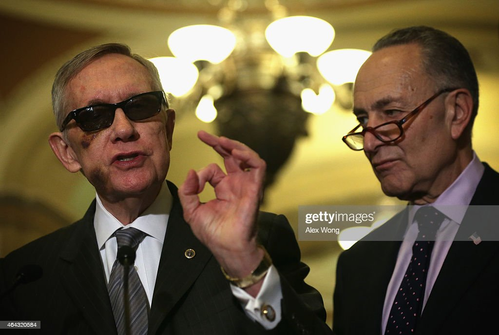 U.S. Senate Minority Leader Sen. <a gi-track='captionPersonalityLinkClicked' href=/galleries/search?phrase=Harry+Reid+-+Pol%C3%ADtico&family=editorial&specificpeople=203136 ng-click='$event.stopPropagation()'>Harry Reid</a> (D-NV) (L) speaks as Sen. <a gi-track='captionPersonalityLinkClicked' href=/galleries/search?phrase=Charles+Schumer&family=editorial&specificpeople=171249 ng-click='$event.stopPropagation()'>Charles Schumer</a> (D-NY) (R) listens during a news briefing after the weekly Senate Democratic Policy Luncheon February 24, 2015 on Capitol Hill in Washington, DC. Senate Democrats held their weekly luncheon to discuss Democratic agenda.