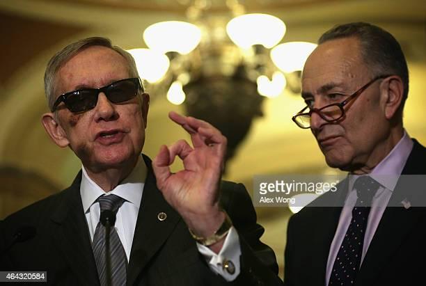 S Senate Minority Leader Sen Harry Reid speaks as Sen Charles Schumer listens during a news briefing after the weekly Senate Democratic Policy...