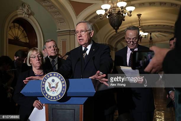 S Senate Minority Leader Sen Harry Reid speaks as Sen Patty Murray Senate Minority Whip Sen Richard Durbin and Sen Charles Schumer during a news...