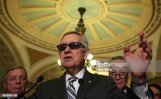 S Senate Minority Leader Sen Harry Reid speaks as Senate Minority Whip Sen Richard Durbin and Sen Charles Schumer listen during a news briefing after...