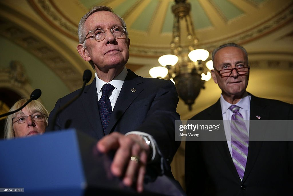 S Senate Minority Leader Sen Harry Reid speaks to members of the media as Sen Patty Murray and Sen Charles Schumer listen after the weekly Democratic...