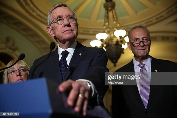 S Senate Minority Leader Sen Harry Reid speaks to members of the media as Sen Patty Murray and Sen Charles Schumer listen after the weekly Democratic...