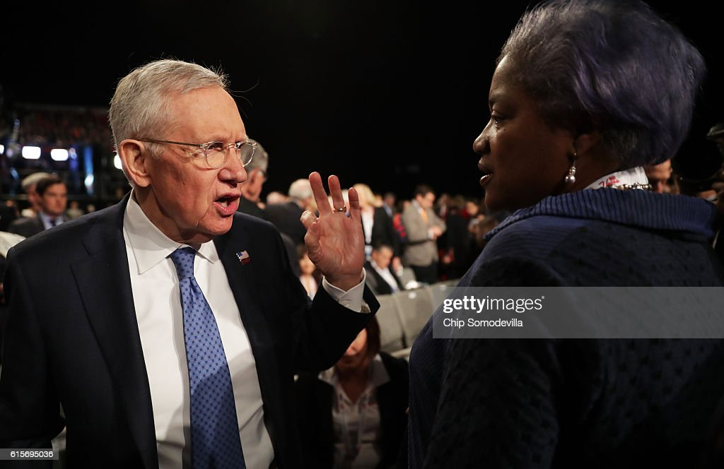 U.S. Senate Minority Leader Sen. Harry Reid (D-NV) speaks with DNC Chair Donna Brazile before the start of the third U.S. presidential debate at the Thomas & Mack Center on October 19, 2016 in Las Vegas, Nevada. Tonight is the final debate ahead of Election Day on November 8.