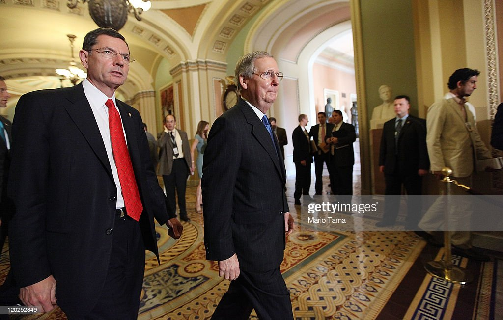 Senate Minority Leader Sen. Mitch McConnell (R-KY) (R) and Sen. John Barrasso (R-WY) walk to address the media after voting on the debt limit bill August 2, 2011 in Washington, DC. The Senate voted 74-26 to approve the bill to raise the debt ceiling, allowing the U.S. to avoid default on its debts.